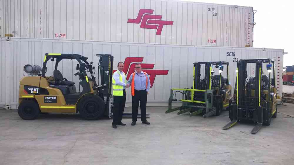 United Victorian State Manager, Brett Whelan, handing over Cat forklifts to SCT National Fleet Manager, Michael Sommers