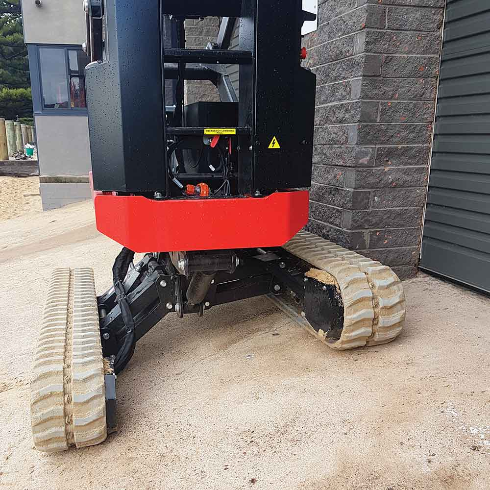 Athena bi-levelling tracked scissor lift working on sloping concrete