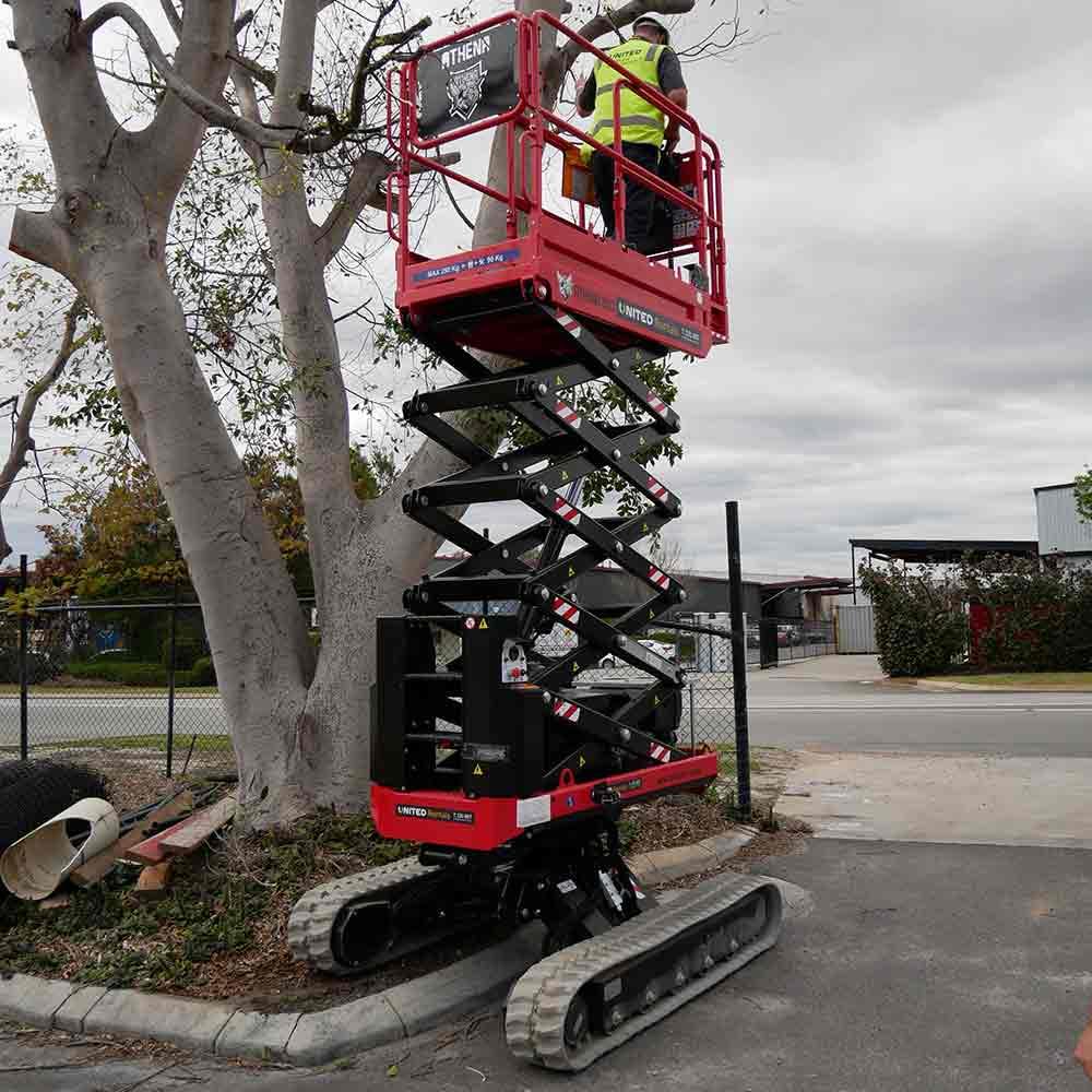 Athena bi-levelling tracked scissor lift easily climbs curbs