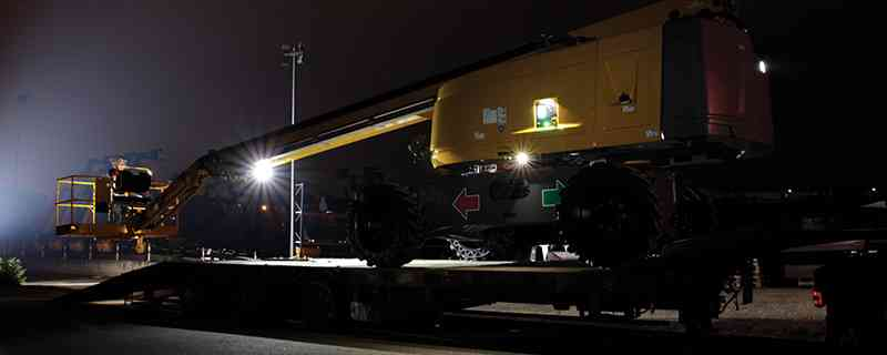 Haulotte HT28 telescopic boom lift includes Active Lighting for safe operation during loadning and unloading at night.