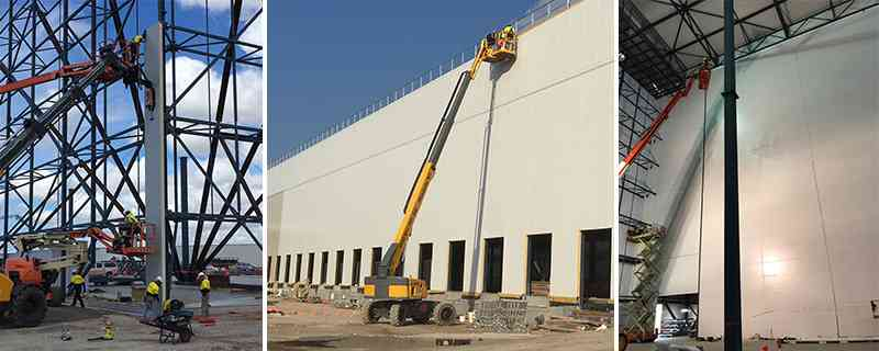 Access equipment including boom lifts and scissor lifts working on the project.