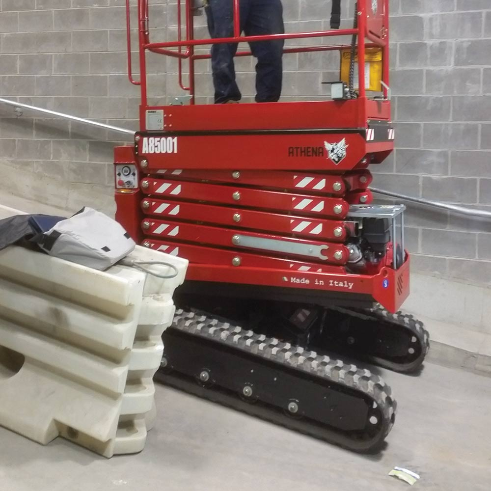 Athena bi-levelling tracked scissor lift working travelling on sloped driveways indoors