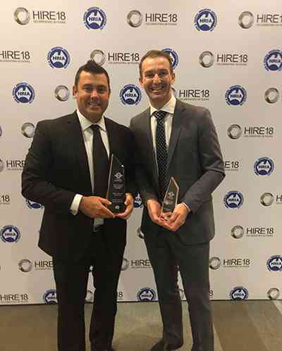 Trent Osborne and Keith Clarke, Haulotte Australia General Manager, holding HRIA awards