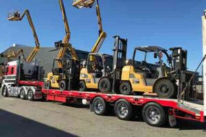 Cat forklifts leaving United for delivery to Optus Stadium for the Ed Sheerin concert
